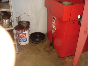 A container of caustic carburetor cleaner. No MSD sheet or protective gear.